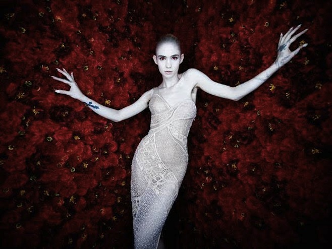 Grimes announce new upcoming tour with hairy armpit picture